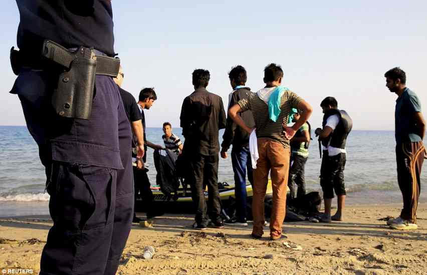 KOS2B326DC400000578-3190377-Stepping_in_Greek_coast_guard_officers_talk_to_the_new_migrants_-a-66_1439044784327