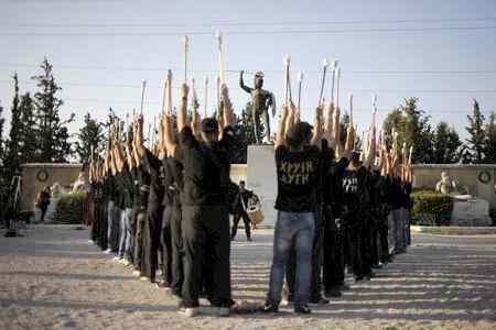 Golden Dawn supporters rehearse for a ceremony in Thermopylae, outside Athens