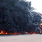 epa05087546 (FILE) A file picture dated 26 December 2014 showing smoke rising from a large fuel depot fire, al-Sidra, Libya, during  fighting. Islamic State militants on 04 January 2016 launched an attack on the port of al-Sidra, Libya's largest oil terminal, military officials said. Clashes between guards at the terminal and the jihadists led to the death of two guards and 10 of the attackers, Omar al-Hassi, spokesman for Libya's Petroleum Guards Force, said. A military official loyal to Libya's internationally recognized government, based in Tobruk in the far east of the country, said the air force had intervened and rebuffed the attack. Islamic State, which is based mainly in Syria and Iraq, controls an area of Libya's Mediterranean coast centred around the towns of Sirte and al-Nofaliyeh, west of al-Sidra.  EPA/STRINGER