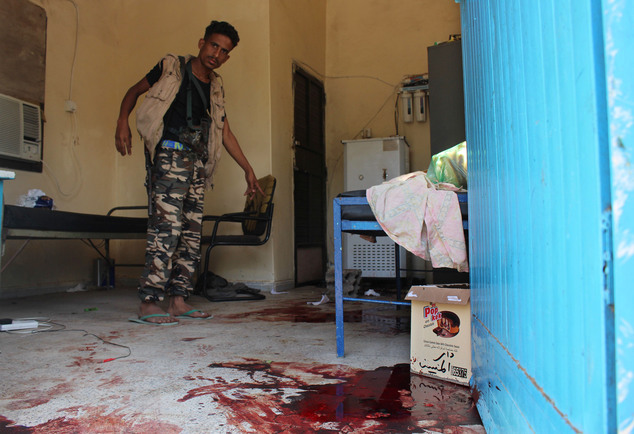 A Yemeni man inspects an elderly care home after it was attacked by gunmen in the port city of Aden, Yemen, Friday, March 4, 2016. Unidentified gunmen stormed a retirement home run by Catholic nuns in the southern city of Aden on Friday shooting more than a dozen people to death, including several Indian nuns, Yemeni security officials and witnesses said. (AP Photo/Wael Qubady)