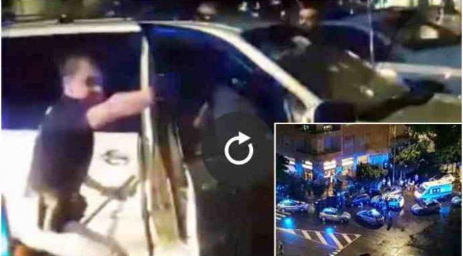 Milano, migrante distrugge 6 auto: folla vuole linciarlo, salvato da polizia – VIDEO