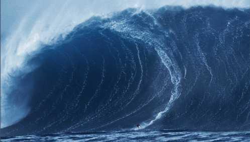 Surfer risolve il suo problema all'occhio usando la forza di un'onda gigante
