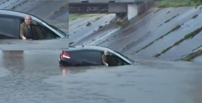 """""""Cosa devo fare?"""", chiede l'automobilista scioccato. E il reporter: """"Nuota!"""" – VIDEO"""