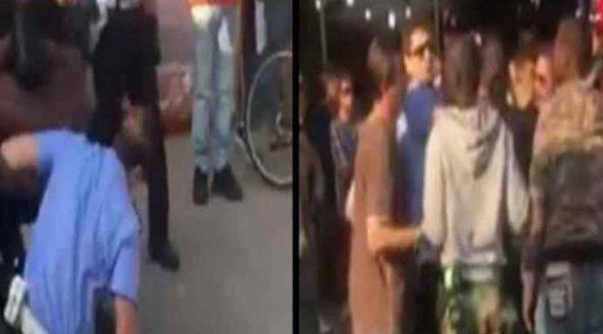Bologna, agenti circondati da immigrati che tentano di impedire arresto – VIDEO