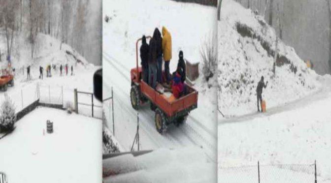 Profughi spalano la neve, gratis, per il boss della Onlus