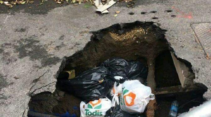 Roma, Voragine alla Garbatella diventa discarica – FOTO