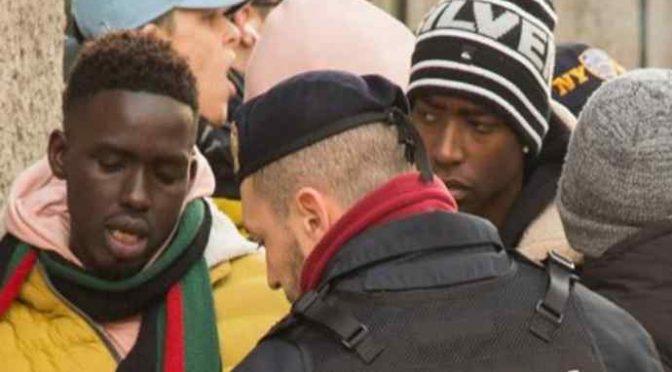 Milano, africani in coda per le scarpe da 500 euro