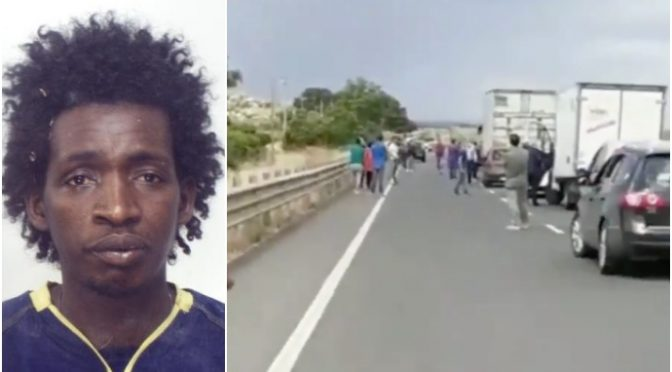 Guerriglia sulla strada: africano assalta auto a pietrate – VIDEO