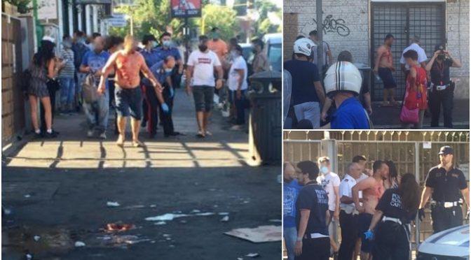 Scontri a bottigliate tra immigrati, terrore alla fermata del bus: vetrina distrutta – FOTO