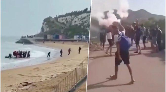 SBARCANO SULLA SPIAGGIA COME TERRORISTI, ACCENDONO FUMOGENI PER CELEBRARE INVASIONE – VIDEO CHOC